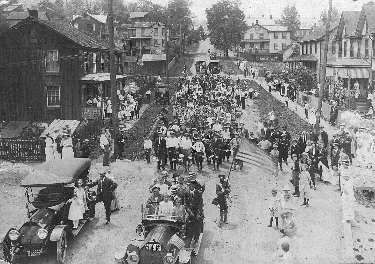 A 1912 parade moves down the hill of present day Rt. 913 in East Saxton.